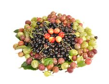 Gooseberry, Currant And Sweet Cherry On A Table Stock Photo