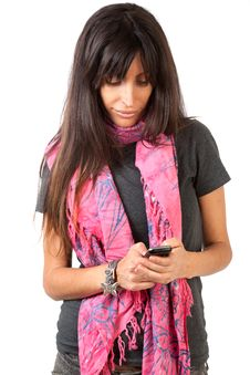 Attractive Brunette Texting A Friend Stock Image