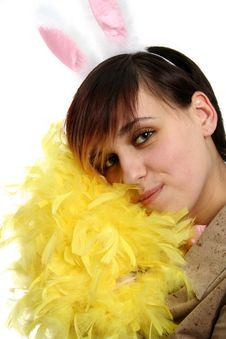 The Young Bunny Girl With Yellow Feathers Stock Photo