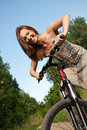 Free Pretty Young Woman With Bicycle In A Park Smiling Royalty Free Stock Images - 20404279