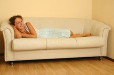 Free Young Woman Lying On The White Sofa Royalty Free Stock Photos - 20407058