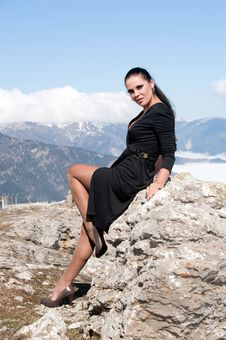 Free Woman In Black Dress Sitting On A Rock Royalty Free Stock Images - 20408839