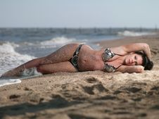 Free Woman Lying On Beach Stock Images - 20409474
