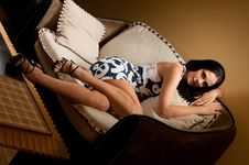Free Woman Lying On The Sofa Royalty Free Stock Images - 20411469