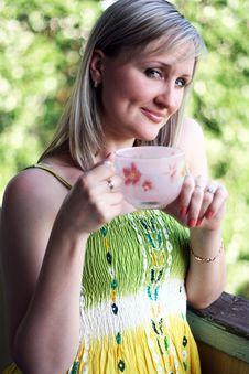 Woman Drinks Coffee Or Tea Royalty Free Stock Photos