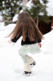 Free Adorable Little Girl Dances In The Snow Royalty Free Stock Photography - 20412487