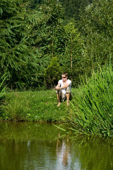 Free Woman Is Fishing On The Pond Stock Image - 20416901