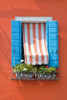 Free Blue Blended Window On Orange Wall Stock Images - 20418034