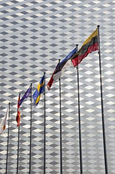 Flags On Modern Wall Background Royalty Free Stock Photos
