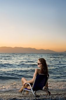 Free Woman Watching Sunset On The Beach Stock Photography - 20419902