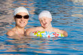 Free Baby With Mother Are Swimming In Pool Royalty Free Stock Photography - 20435777