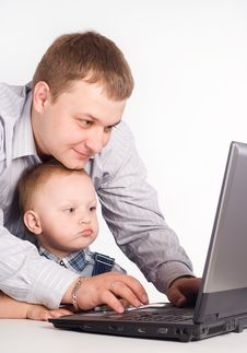 Dad With Son And Laptop Royalty Free Stock Photography