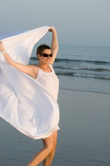 Woman Is Running On The Beach With White Shawl Royalty Free Stock Photos