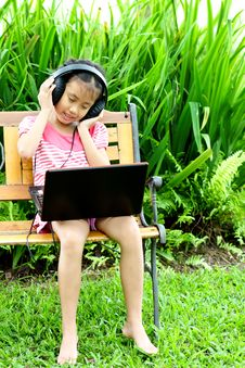Free Girl Listening To Music From A Laptop Royalty Free Stock Images - 20434219