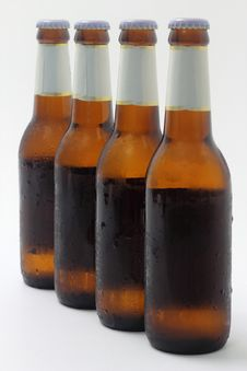 Free Four Bottles Of Beer Stock Photo - 20434650