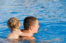Free Baby On The Father S Neck Is Swimming In Pool Royalty Free Stock Photography - 20435797