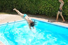 Free Woman Jumping To Swimming Pool Stock Image - 20440581