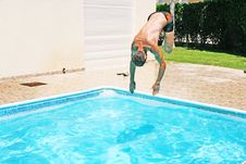 Free Man Jumping To Swimming Pool Royalty Free Stock Photography - 20440617