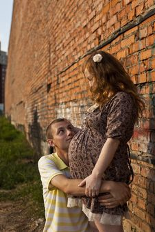 Free Young Man Kisses His Pregnant Wife Stock Photos - 20442743