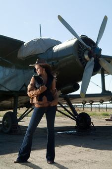 Woman In Jeans And Aircraft Royalty Free Stock Photography