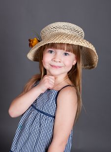 Little Girl In A Dress With A Straw Hat Stock Images