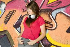 Free Girl With Headphones And Graffiti Wall Stock Photo - 20444740