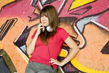 Free Girl With Headphones And Graffiti Wall Royalty Free Stock Photography - 20444747