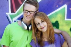 Free Teens Near Graffiti Wall. Royalty Free Stock Image - 20445486