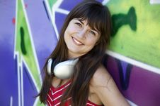 Free Girl With Headphones And Graffiti Wall Royalty Free Stock Image - 20445556