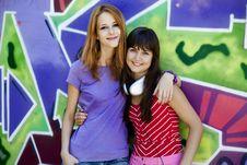 Free Two Girlfriends Near Graffiti Wall. Royalty Free Stock Image - 20445596