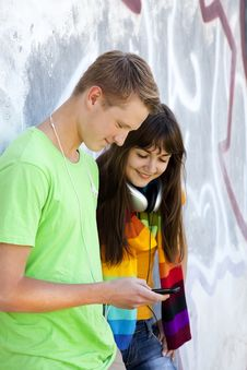Free Teens With Headphones Near Graffiti Wall. Stock Photos - 20445653