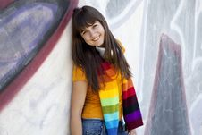 Teen Girl With Earphones Near Graffiti Wall. Stock Images
