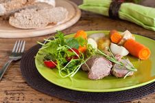 Pork Tenderloin With Potato And Salad Royalty Free Stock Images