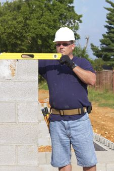 Mason With Concrete Block Stock Photography