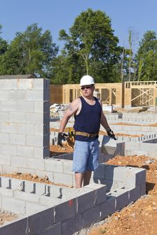 Mason With Concrete Block Stock Image