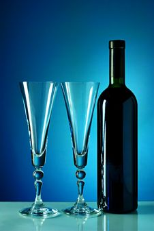 Free Wine Bottle And Glass On A Blue Background Stock Image - 20449691