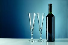 Free Wine Bottle And Glass On A Blue Background Royalty Free Stock Image - 20449696