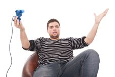 Furious Man With A Joystick For Game Console Royalty Free Stock Photography