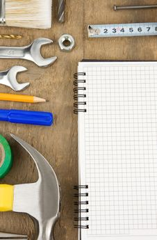 Free Pad And Tools On Wood Stock Photography - 20450742