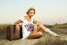Free Pretty Girl Sitting On A Suitcase Royalty Free Stock Photo - 20457095