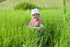 The Girl On A Meadow Stock Photo