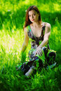 Free Brunette Sitting On Green Grass Stock Photography - 20462442