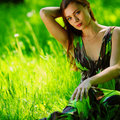 Free Brunette Sitting On Green Grass Stock Images - 20462454
