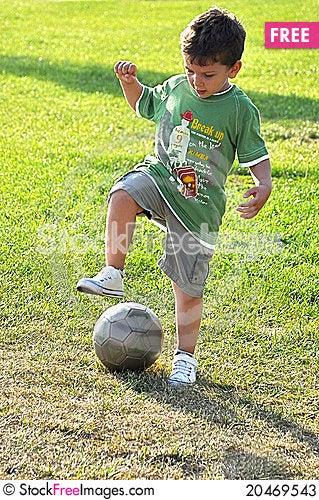 Young boy tackling ball Stock Photo