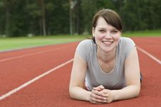 Free Young Woman Stretching On Running Track Royalty Free Stock Photos - 20461528