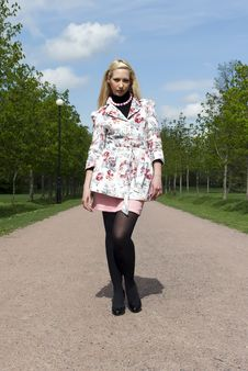 Free Blonde Girl Standing In The Park Stock Image - 20461531
