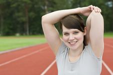 Free Young Woman Stretching On Running Track Royalty Free Stock Image - 20461536