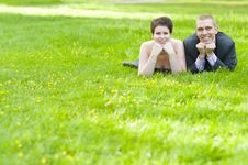 Happy Couple Lying On The Grass Stock Photos