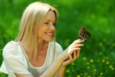Free Woman Playing With A Butterfly Stock Images - 20462314