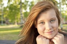 Free Young Woman Sitting On A Park Bench Royalty Free Stock Photography - 20462357